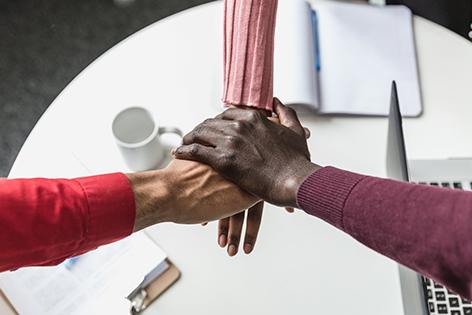 three-team-hands